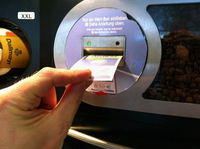 Опускание чека Санифейр в кофе-автомат